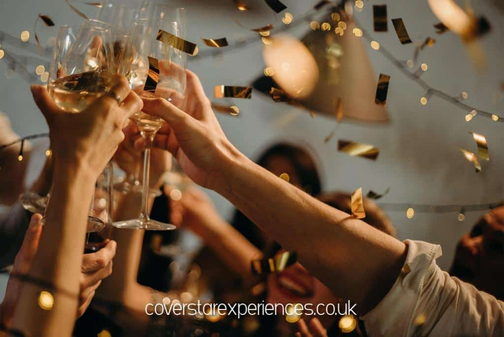 A photo of people toasting with glasses