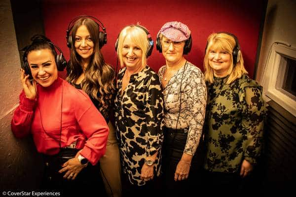 A photo of a group of ladies with headphones on